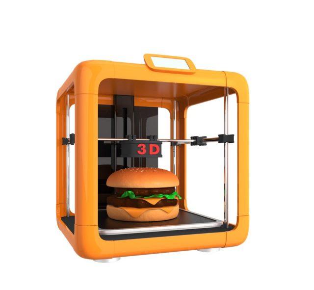 Une imprimante alimentaire 3D en train de fabriquer un burger